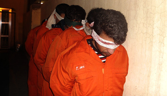 Blindfolded suspected militants, with possible links to al-Qaeda, are seen at Iraqi police headquarters in Diyala province