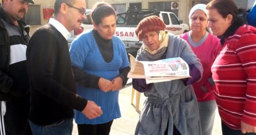 raheel_old_woman_erbil_refugee_newspaper