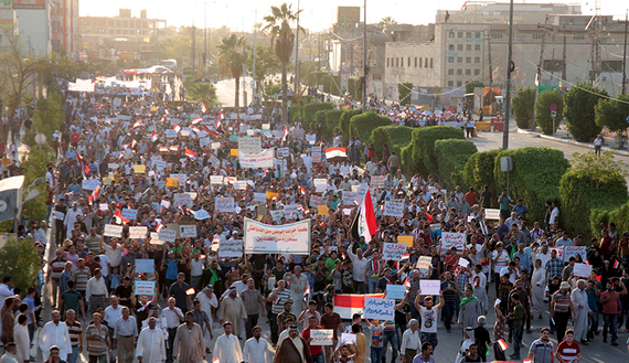 People shout slogans during a demonstration against corruption and poor services in regard to power cuts and water shortages, in Kerbala